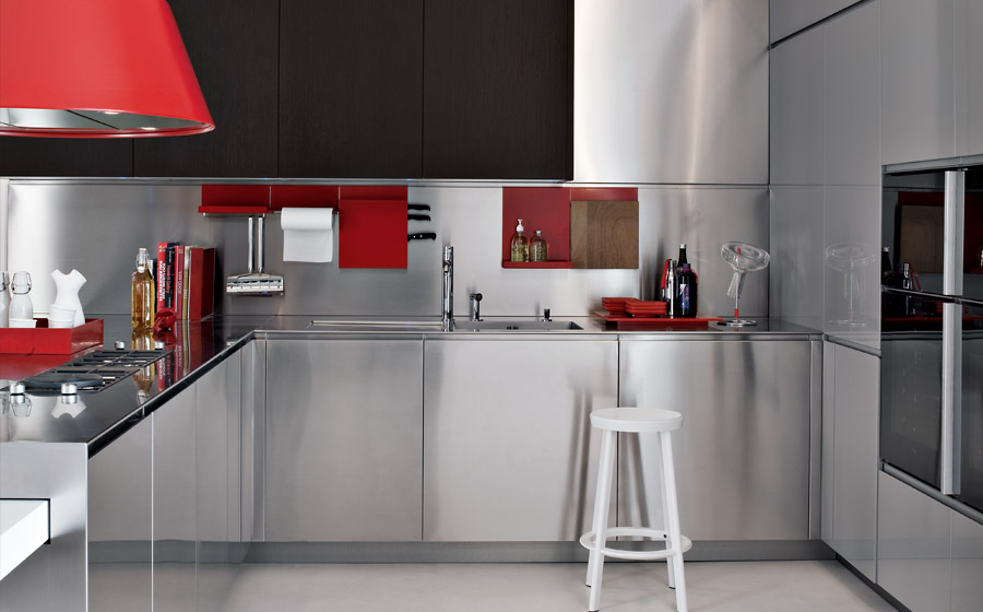 Sparkling stainless steel conutertop and light gray cabinets give the kitchen a refined appeal