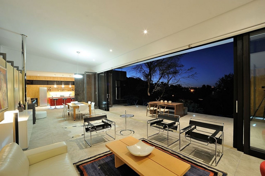 Stackable sliding glass doors connect the fabulous interior with the outdoor