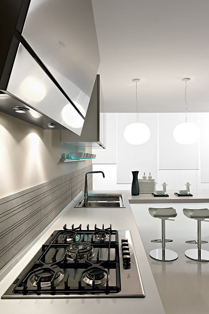 Stainless steel kitchen surfaces couple with white marble in a functional fashion