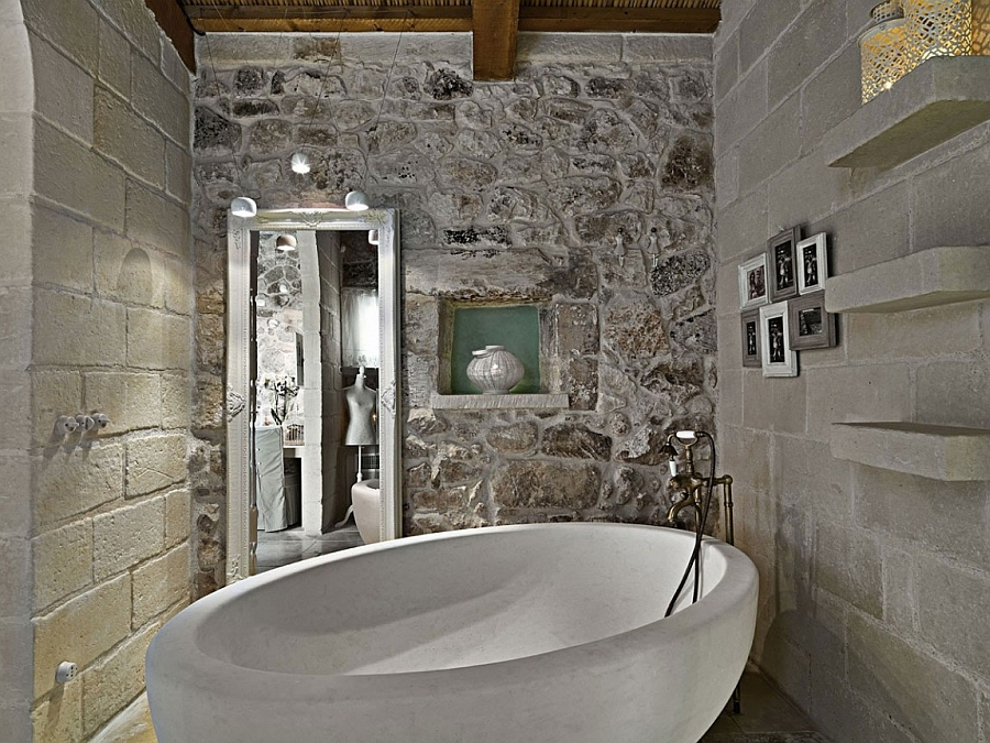 Standalone bathtub steals the show in the rustic bathroom