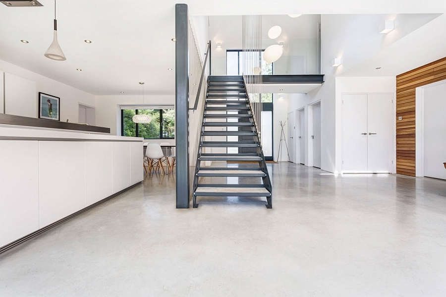 Steel wires hang around the staircase giving it a contemporary appeal