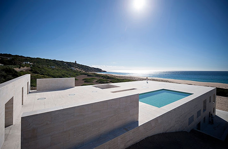 Stoic stone walls protect the house from the strong winds House Of Infinite: Astounding Beach Retreat Where Myths Meet Minimalism!