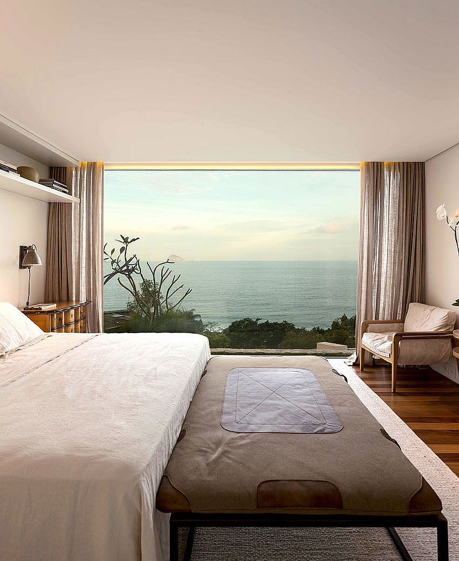 Stunning bedroom offers amazing view of the ocean in the distance