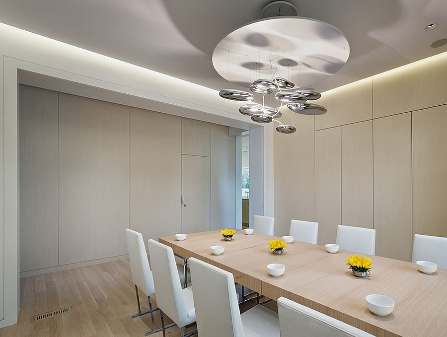 Stunning pendant light above the dining table adds metallic magic to the dining room
