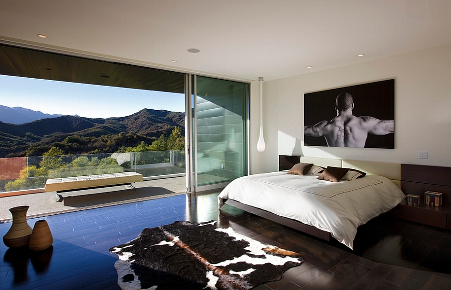 Stunning view outside instantly elevates the appeal of this gorgeous bedroom with a masculine style