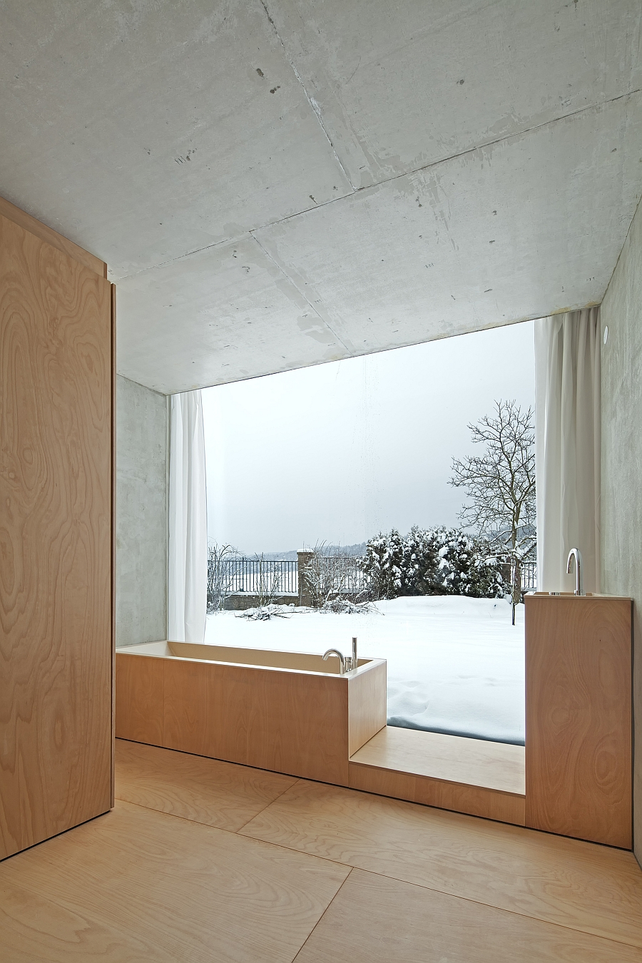 Stylish bath with a view of the scenic landscape outside