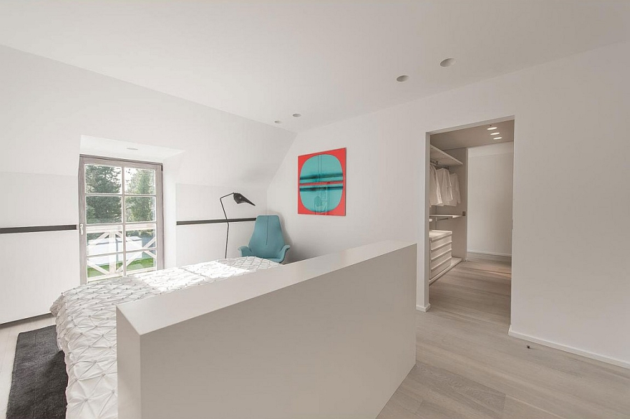 Stylish contemporary bedroom in white with ample natural ventilation