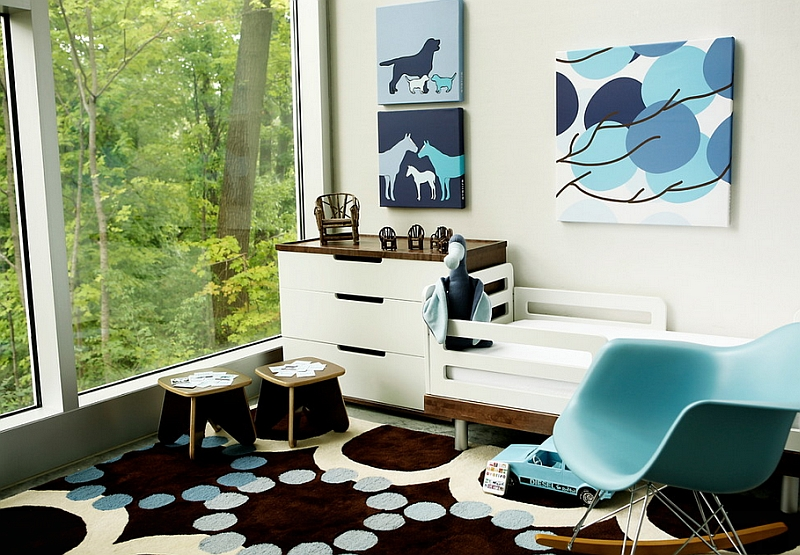 Stylish nursery combines different shades of blue with dark browns