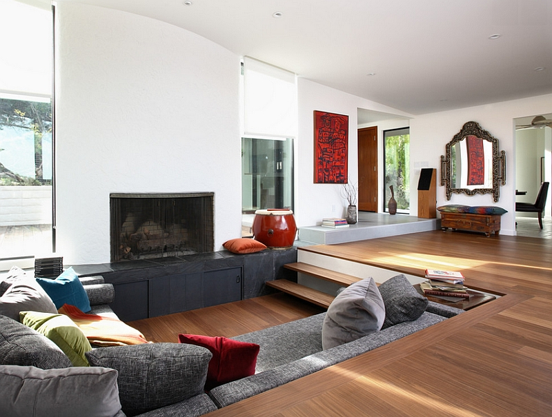 Sunken seating in the living room with the fireplace as the central focal point of the space