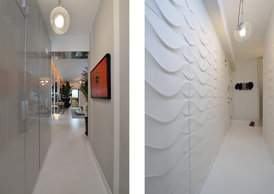 Textured 3D boards with a wave pattern at the entrance add contrast to the sleek home