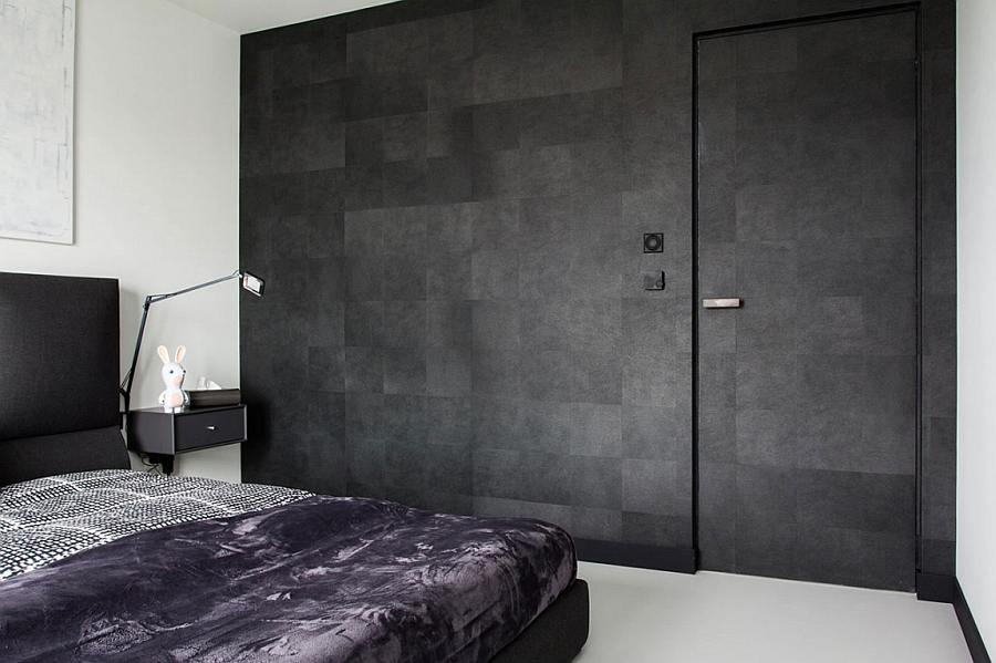 Textured wall in the bedroom offers much needed contrast in the two-color palette bedroom