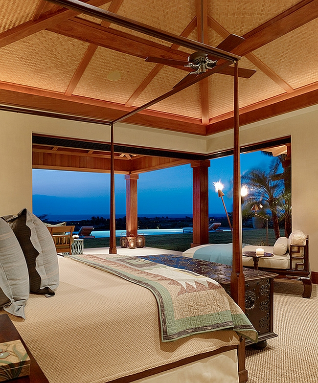 The corner of the bedroom opens up to scenic views outside