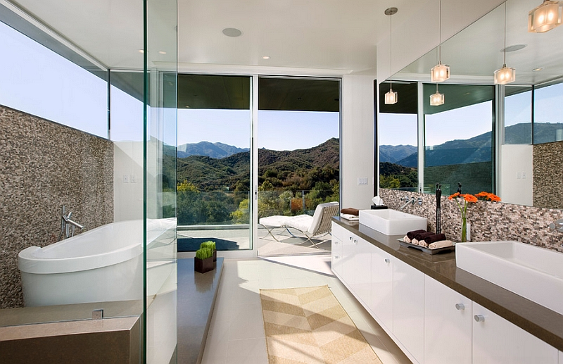 The hills in the distance add to the overall appeal of this spa-styled bathroom