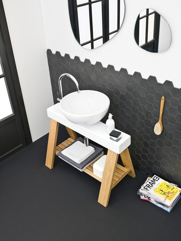 The hip stand below the sink adds a touch of organic charm to the bathroom