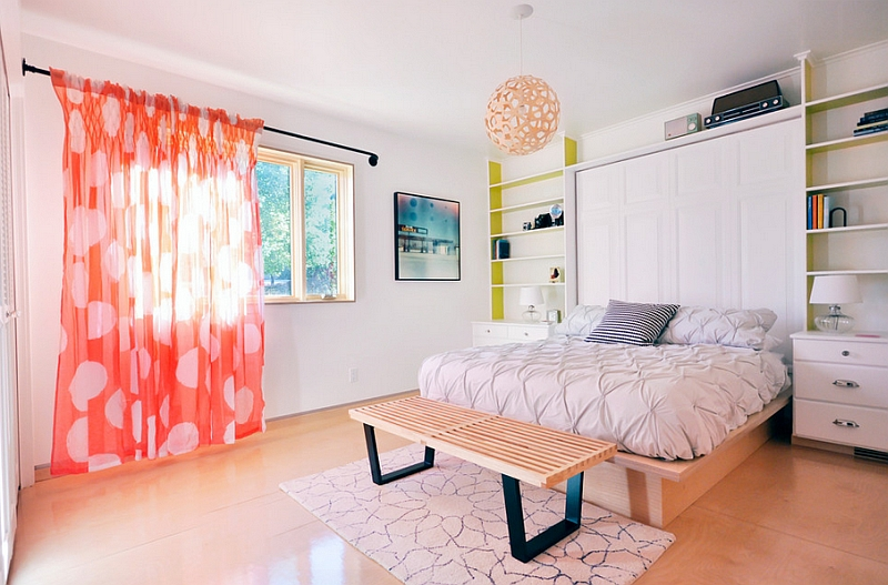 The light orange light filteing into the room adds to the beauty of the coral pendant