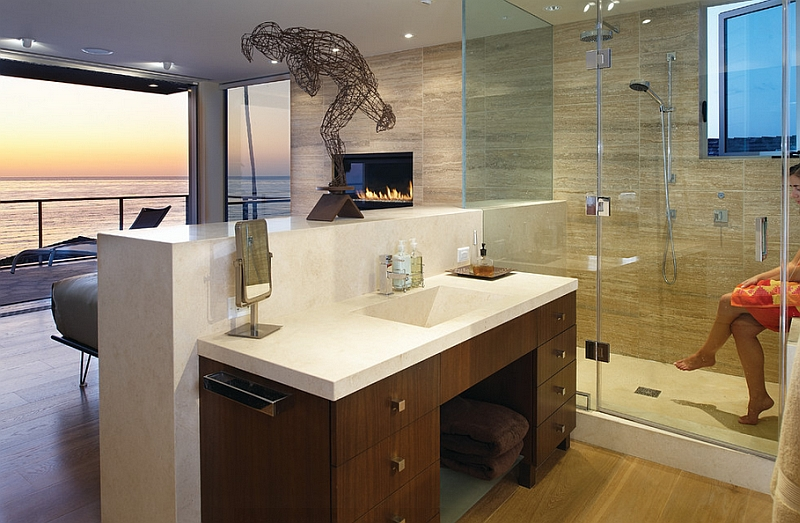 The visual of the fireplace and the ocean add to both the bedroom and the bath