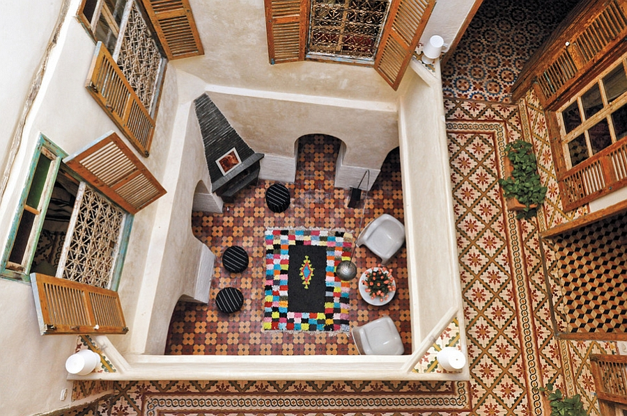 Top view of a stylish Moroccan courtyard with hand-painted tiles and colorful decor