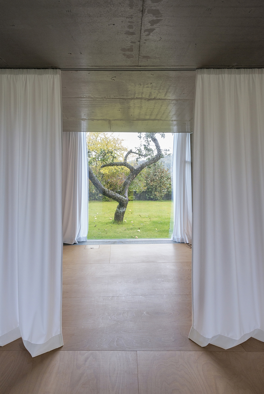 Track-mounted curtains allow you to shift between privacy and unabated views