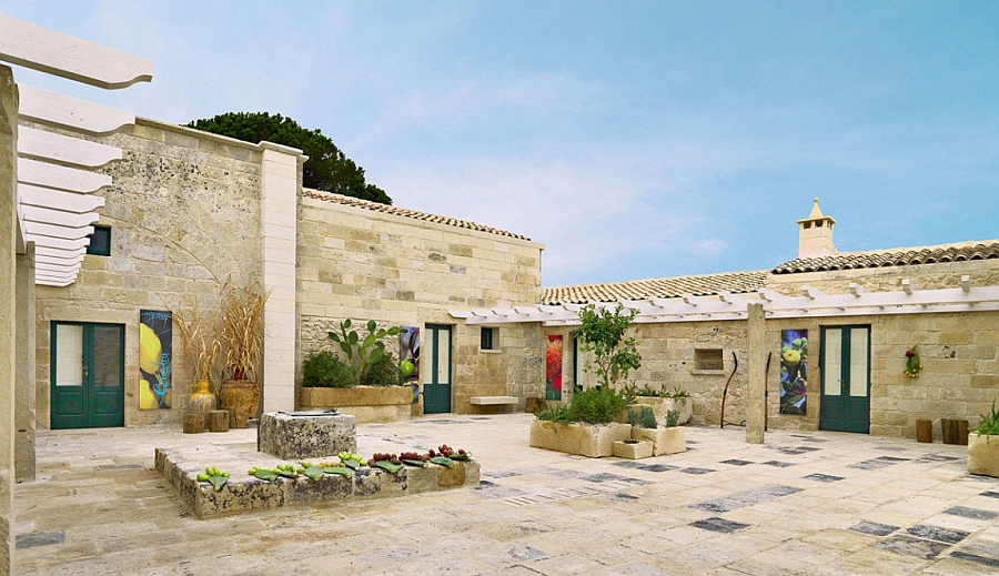 Traditional Italian architecture and lovely courtyards greet you at the Relais Masseria Capasa