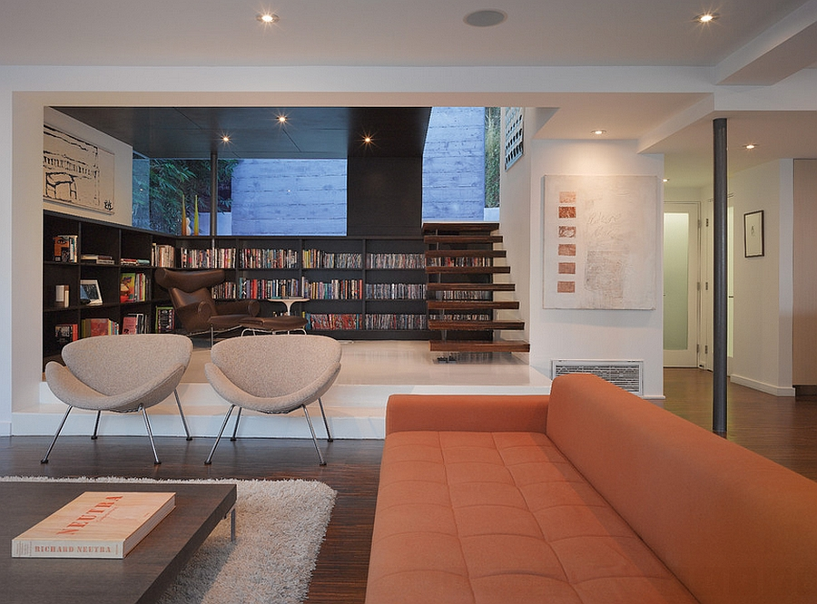 Twin orange slice chairs in the modern living room in Los Angeles [Design: Griffin Enright Architects]
