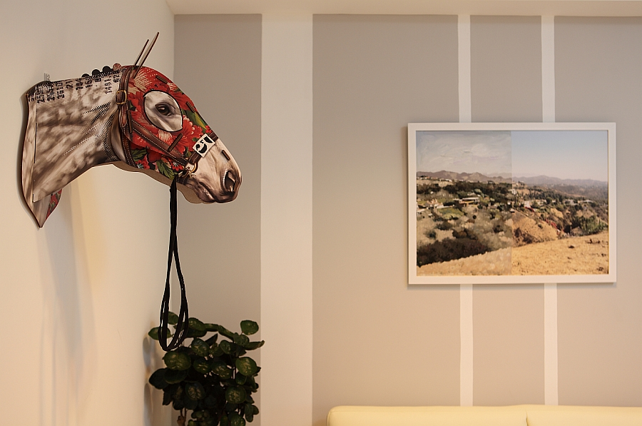 Unique accessories and wall art enliven the room