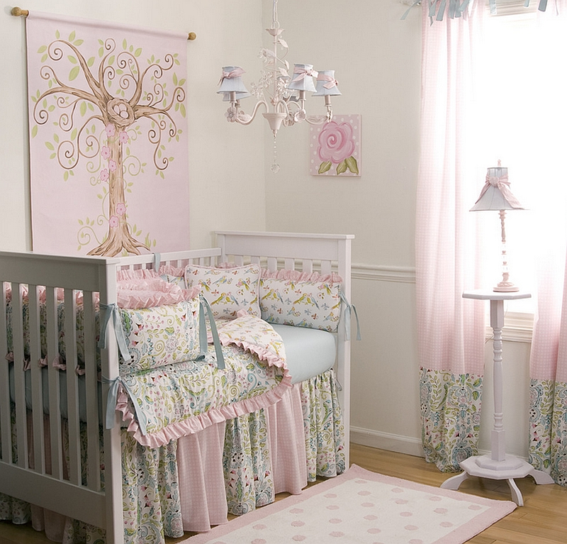 Use of intricate pattern and love birds decorative pillows compensates for the lack of bold colors in this chic pink nursery