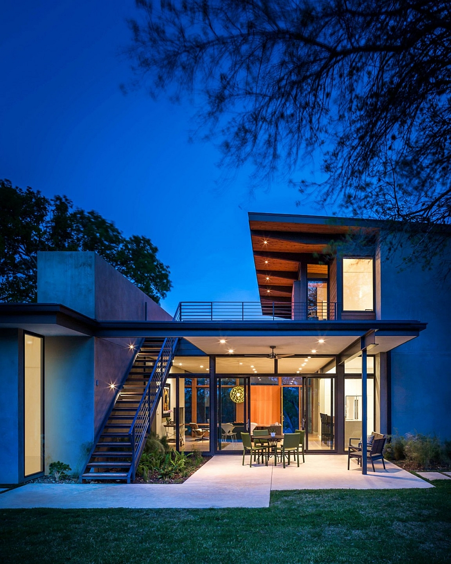 Warm lighting gives the trendy home a welcoming appeal after sunset