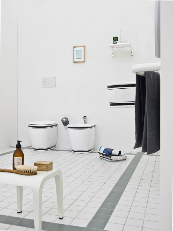 White wc and bidet with black edges and matching floating vanity in the toilet