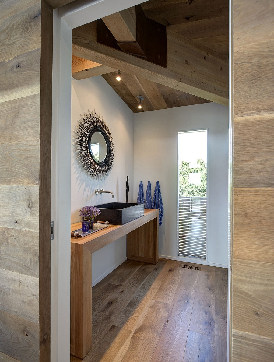 Wood brings some much needed warmth to the steel and glass home