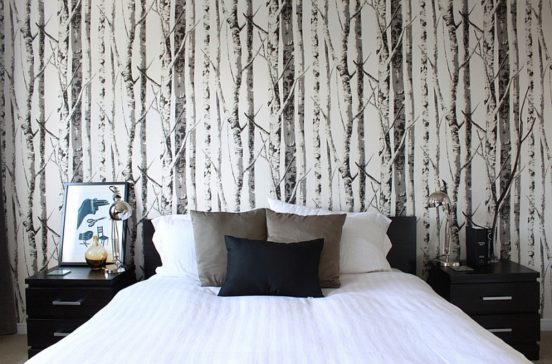 Woodsy wallpaper gives the cozy bedroom an entirely new look