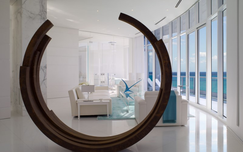 A modern sculpture in a living room designed by Jennifer Post