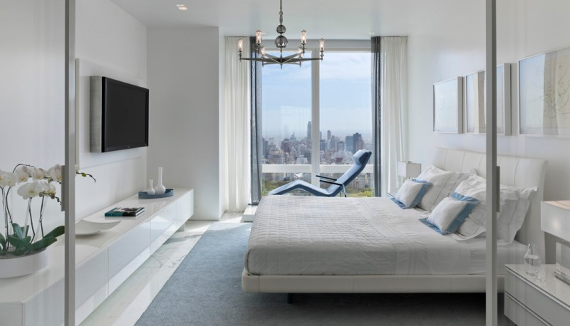 Abundant windows in a Manhattan bedroom designed by Jennifer Post
