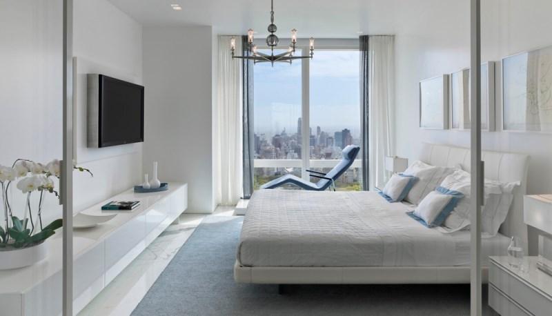 Abundant windows in a Manhattan bedroom designed by Jennifer Post