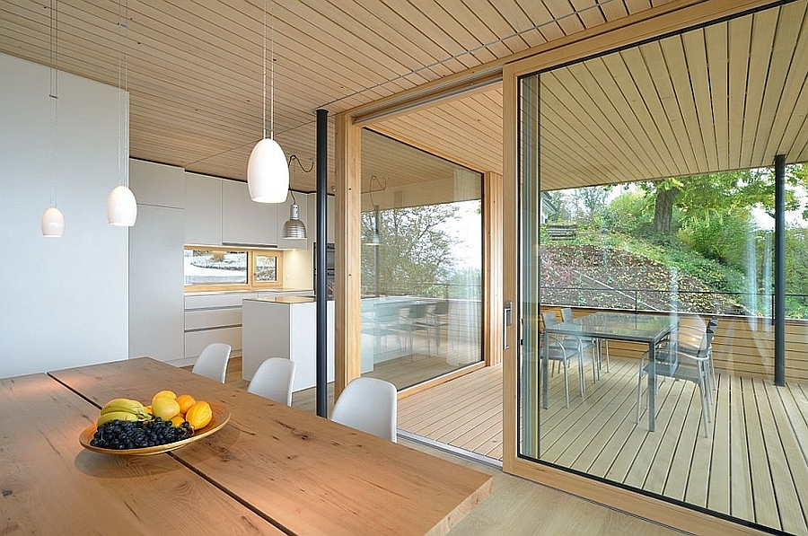 Beautiful balance between wood, concrete  and glass isnide the house