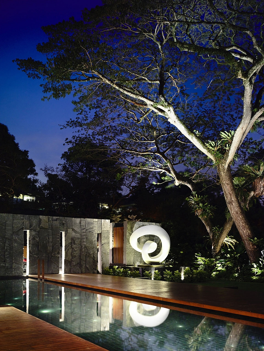 Beautiful lighting and sculptural additions bring the backyard alive after sunset