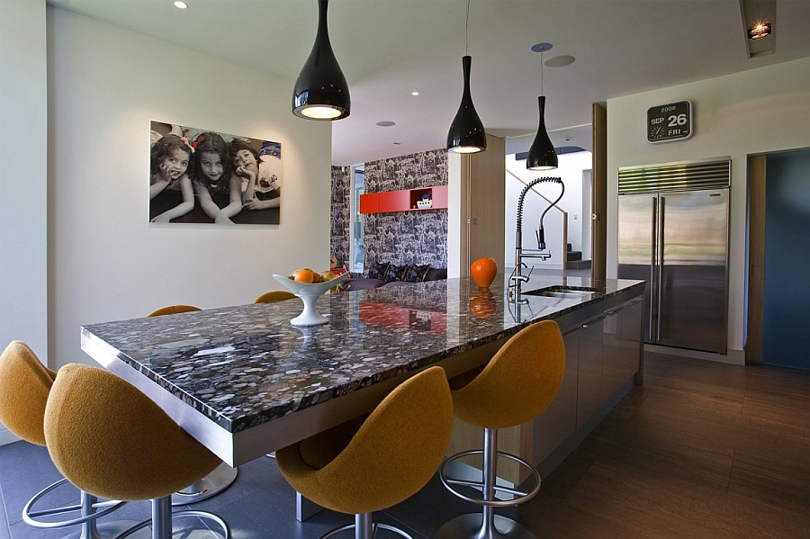 Beautiful pendant lights above the kitchen island add style to the space