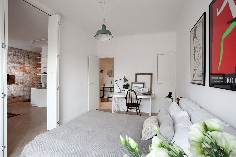 Bedroom with Scandinavian style and a small work area