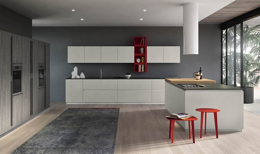 Bright splashes of red enliven the minimal kitchen