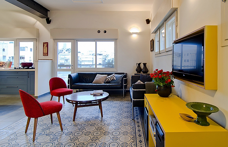 Bright yellow cabinets television niche add style to the space Colorful Renovation Brings Old World Charm To Small Tel Aviv Apartment