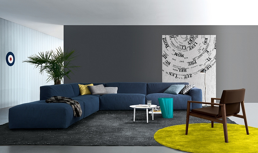 Coffee table in white stands out visually thanks to the bold couch in blue Exquisite Coffee Tables That Add A Curvy Twist To Your Living Room!