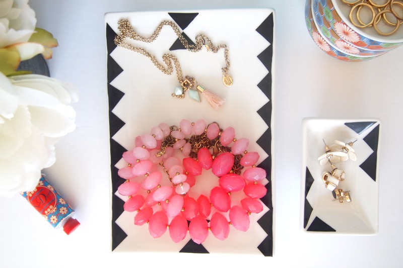 Colorful jewelry additions look best in a black and white tray
