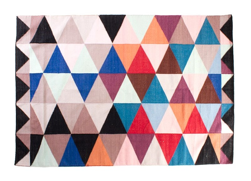 Colorful woven rug with geo triangles