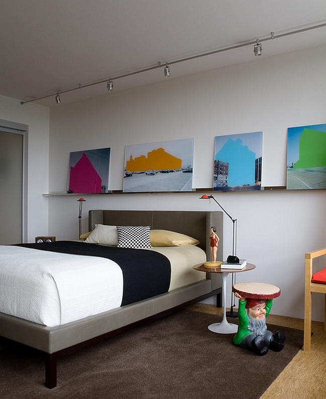 Colors of the wall art complement those of the gnome [Design: Johnson Berman]