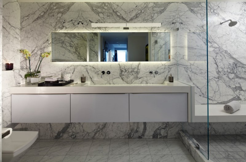 Contemporary bathroom with marble walls and flooring