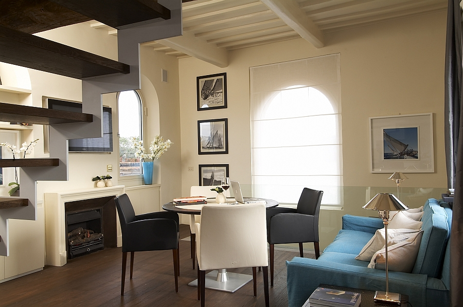 Dark wooden floor and ceiling beams bring old world charm to the contemporary suite