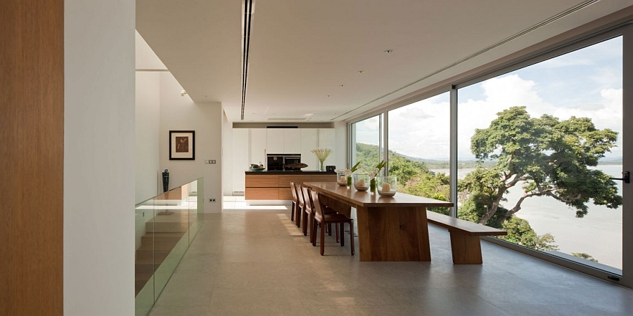 Dining room with glass walls opens up towards the sea