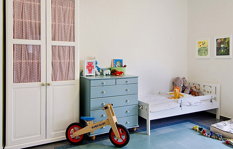 Elegant nursery with a chic wallpaper and cool colors