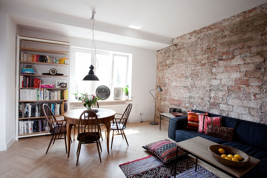 Exposed brick wall adds texture to the living room