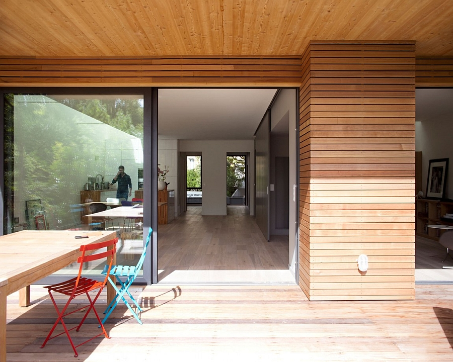 Extended deck of the house brings the living space outdoors