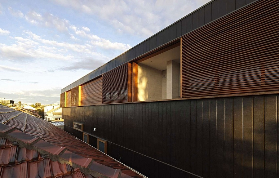 Exterior of the Plywood House combines ample ventilation with private quarters